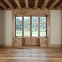 Eingangselement aus Altholz und Glas
