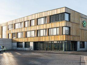 Altholz zur Fassadenverkleidung für die Stadtwerke Neustadt (Holstein)